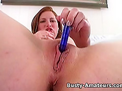 Busty Ginger playing her tits and pussy