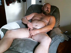 Dishy guy is masturbating in the guest room and filming himself on webcam