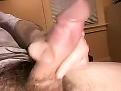 Attractive dude is frigging within doors and shooting himself on webcam