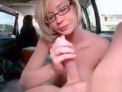 Amateur in glasses blowing dick for hot cum