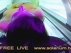 Hot Horny Girl masturbates in Public solarium