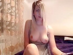 Sweet blonde with a cute smile flashes her perky boobs for Part 03