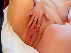 Mature lady teases by spreading her massive pussy with both hands