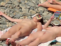 Nudist girls expose bodies at the beach-