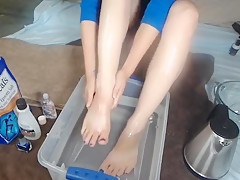 Beautiful Goddess soaks feet paints toes and rubs them down with oil