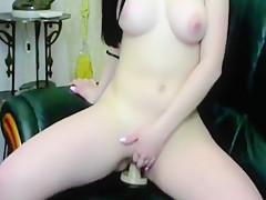 girl in high white heels fucks herself in the vagina