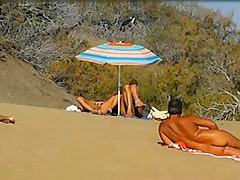 Slutwife masturbating for pervs in a beach