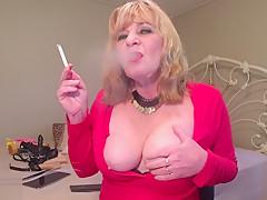 Sexy heavy make up enjoying my smoke boobies out