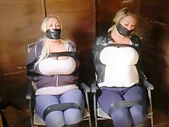 2 busty ladies tied in a shed-