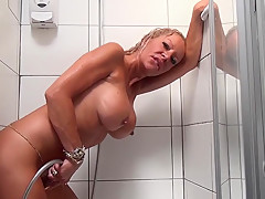 Hot blonde MILF takes shower and do dirty things