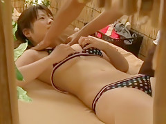 Asian doll has a massage on the beach part4