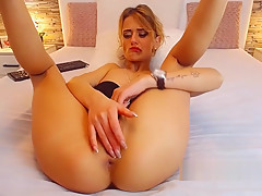 Europenan babe plays with her clit while fucking her tight ass with dildo