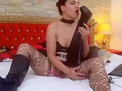 Leather webcam babe licks her own boots