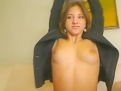 Pretty cam girl goes topless to model jacket