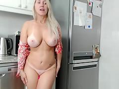 The blonde masturbates in front of the webcam