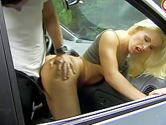 Blonde hitchhiker gets fucked in the car