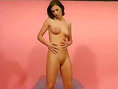 Brunette masturbates on her chair