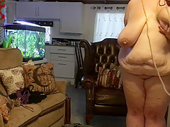 BBW slave girl gets her tits tied. Predicament bondage with an anal hook.