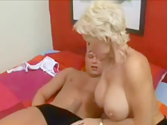 Mature blonde fucks the guest