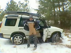 Couple sex play in the snow