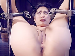 Asian spanked with waist in wooden stock
