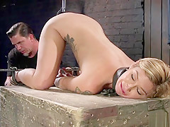 Tattooed blonde feet and pussy tormented