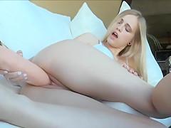 Cute blonde fucks herself with a dildo