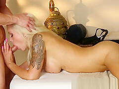 Busty massage babe sucking her masseur