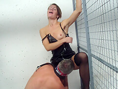 Young dirty police woman punished a submissive man in a prison