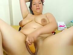Enticing BBW Hustler With Her Dildo-