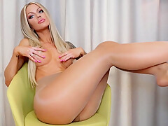 Busty bombshell showing her sexy tattooed ass and body in pantyhose-