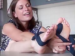 Sexy dark haired housewife wraps hot black nylon stockings around her feet