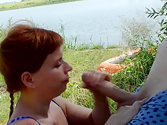 Mature Tinder date sucking cock by a lake