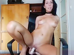 Brunette NicoleReed massages and fucks her pussy