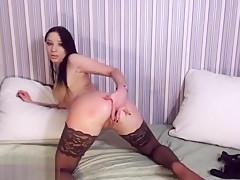 Brunette Bella Anders in black stockings