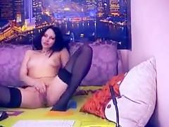 Bagirrra brunette lying on the sofa in some black stockings