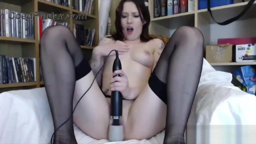 British red flower Mia Fox in stockings and braces