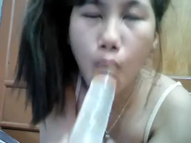 Pinay with lovlytits sucking her big toy