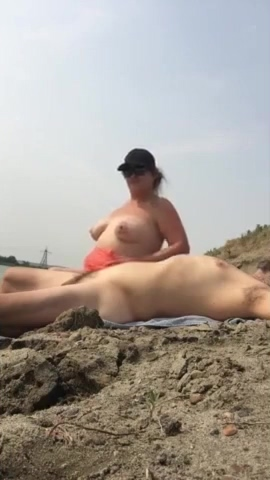 Fat wife having some sexy time on the beach with a hubby