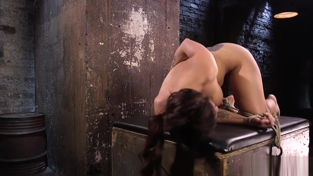 Hogtied slut suffers caning
