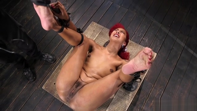 Ebony tormented in device bondage