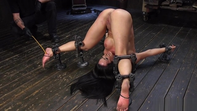 Bent over forward in metal device bondage